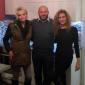 Roman Machník, realitní makléř, s klienty u předání bytu